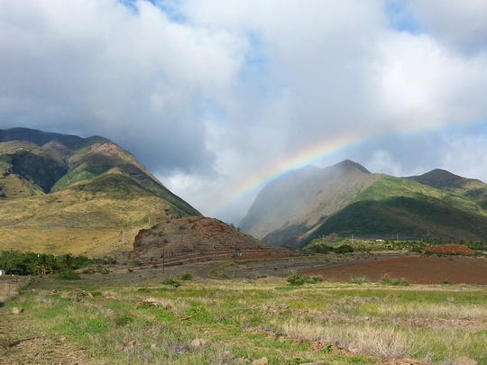 A rainbow arches over Olowalu Valley after light rains descend.  The Olowalu Cultural Reserve is located on Maui's west side just four miles south of the busy, tourist town of Lahaina.