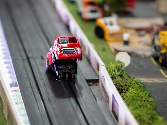 Gregory Burchell tricked out some of his miniature die-cast cars to pop wheelies.