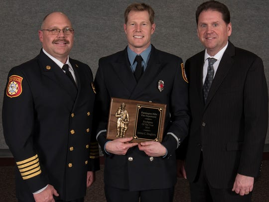 Farmington HIlls Firefighter of the Year Lt. Jeremy Dougherty (center) with Fire Chief John Unruh (left) and City Manager Dave Boyer.