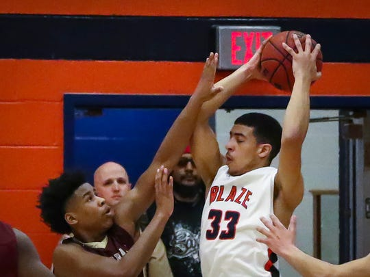 Blackman's Trent Gibson is pressured in the paint Saturday.