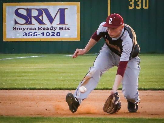 Riverdale shortstop Brett Dingess charges a grounder