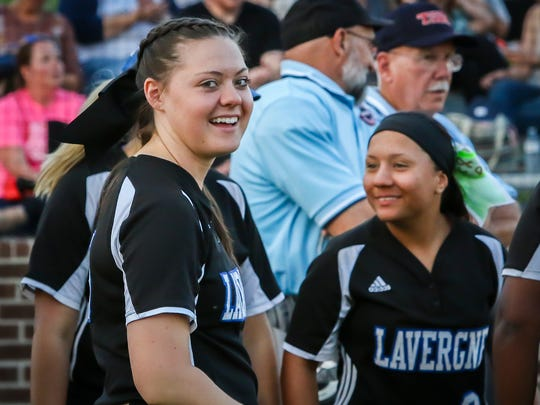 La Vergne's Skylar Filorimo (left) talks with teammates prior to Tuesday's game at Riverdale.