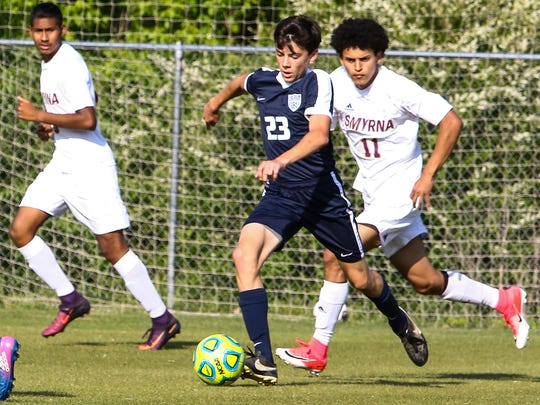 Siegel's Adam Lalance (23) and Smyrna's Orlando Jerez (11) battle for possession during Monday's 7-AAA quarterfinal contest, won by the Bulldogs 1-0.