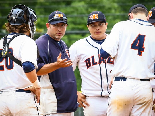Blackman coach Justin Entrekin talks to players during