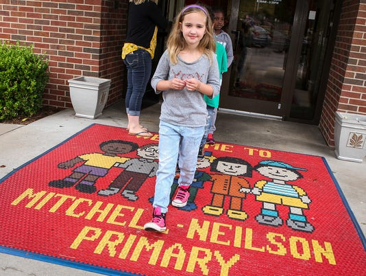 636313323120308452-Kaycee-Barnes-leads-students-out-the-door.jpg