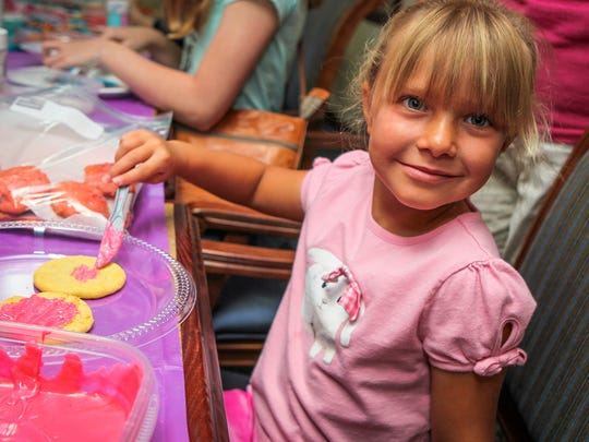 Ella Taber, 5, decorates a cookie Tuesday morning before helping to deliver plates of them to the fire station in downtown Murfreesboro. Barnabas Vision volunteers decorated and delivered cookies to Rutherford County first responders Tuesday.