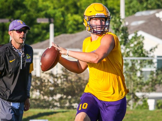 Smyrna senior QB Caleb Perkins rolls out during 7-on-7 action Tuesday.