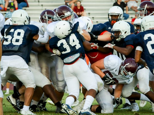 Blackman defenders wrap up a Franklin player during