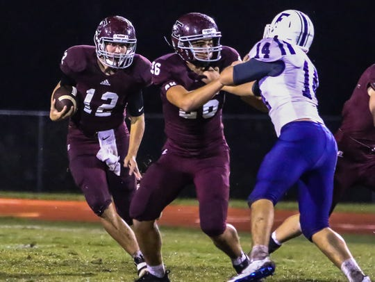 Quarterback Ethan Cobb (12) is back for Eagleville after a Mr. Football semifinalist campaign in 2017.