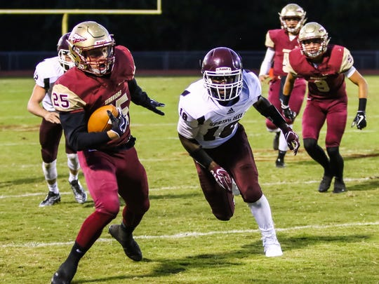 Riverdale's Michael Scruggs avoids a Spring Hill tackler during Friday's 49-24 Warrior win.