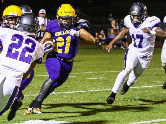 Smyrna's Blake Watkins tries to get around Cane Ridge defenders Friday night.