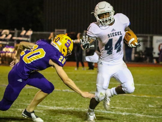 Smyrna's Bailey Woodall pursues Siegel's Lelan Wilhoite