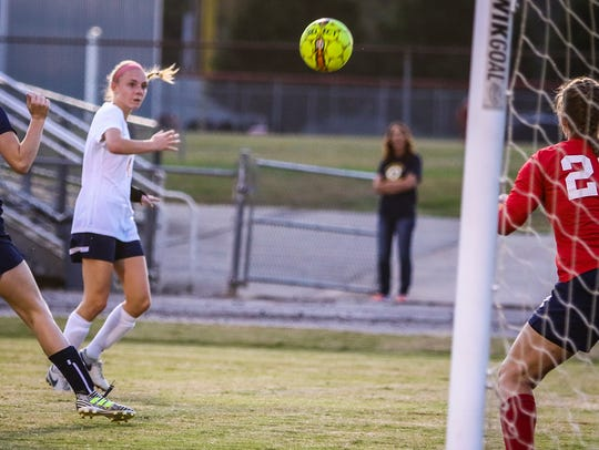 Oakland's Claire Watson fires to the goal during Saturday's