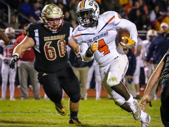 Blackman's Jordan Brown carries the ball during a 2017 game. Brown rushed for nearly 500 yards a year ago.