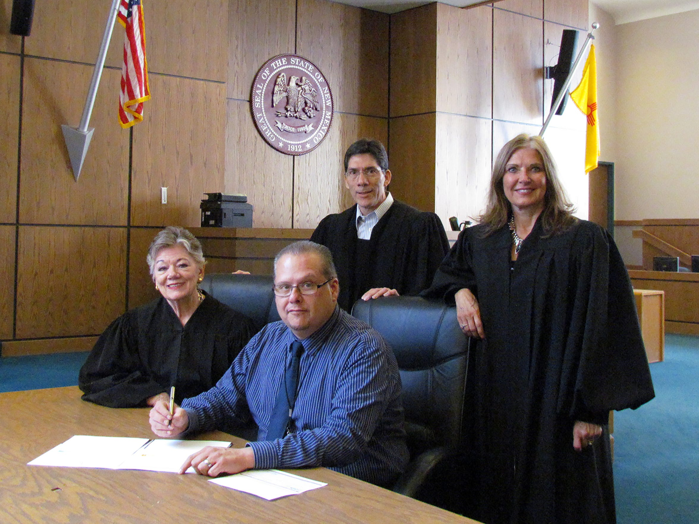 Adult Drug Court Program Manager David Borunda and Drug Court Judges seated: Judge Mary W. Rosner, from left standing Judge Manuel I. Arrieta and Judge Marcy E. Beyer. If Rosner has her way, a mental health court will be established in Doña Ana County by 2021.
