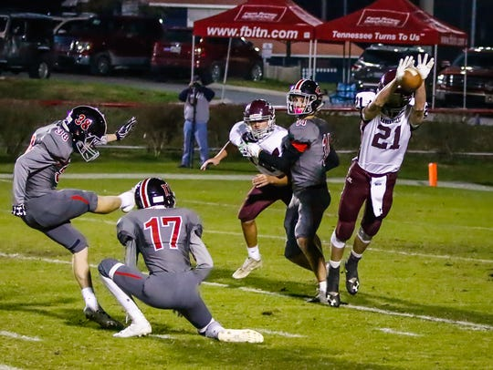 Eagleville's Trevor Griffin (21) attempts a blocked kick during a 2017 playoff game. Griffin will be one of the Eagles' top targets at wide receiver in 2018.