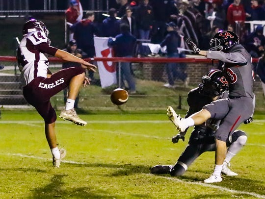 Eagleville's Avery Sparks blocks a Columbia extra point try during the Eagles' 40-14 loss Friday in the 2A state playoffs.