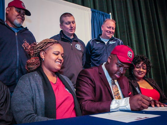 Siegel's Maxwell Iyama signs with South Carolina on Wednesday, Dec. 20, 2017.