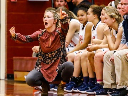 Dickson County coach Catie Embrey shouts instruction