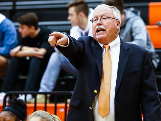 MTCS girls basketball coach Lynn Burkey directs his squad during a game against Providence Christian earlier this season. Burkey will move to an assistant coach role next season.