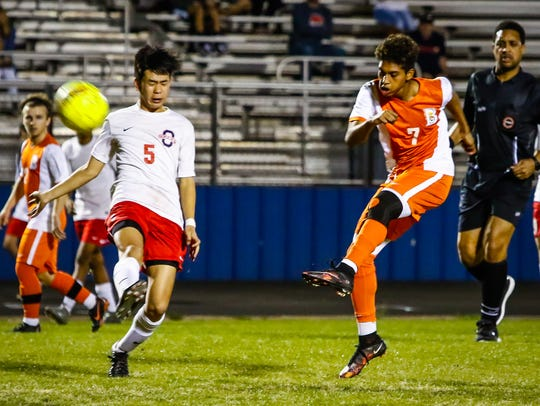 Blackman's Nemo Lazo gets into a kick as Oakland's Baylee Rutsadavong defends Tuesday.