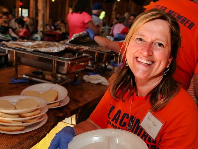 Sherry Tidwell serves guests at the 69th annual Blackman