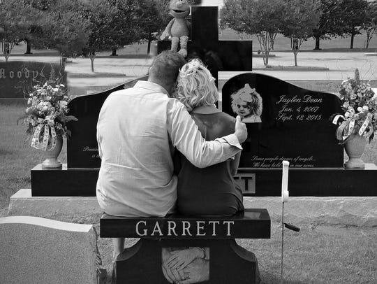 Jaylen Garrett's parents Anthony and Cindy look over