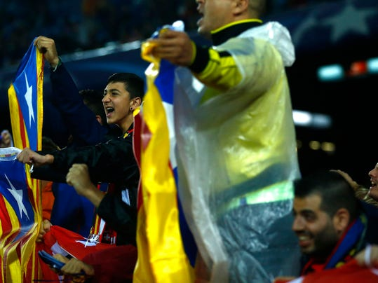 "In this photo dated Saturday, Oct. 21, 2017 photo, Barcelona fans wave esteladas or independence flags during the Spanish La Liga soccer match between FC Barcelona and Malaga at the Camp Nou stadium in Barcelona, Spain. The Camp Nou Stadium in Barcelona is not only one of soccer's biggest and most famous venues but also a tremendous echo chamber for Catalans who want independence from Spain, with the rallying cry seeming to become louder than usual with the prosperous region locked in a struggle with the government in Madrid.  When Barcelona plays, fans chant ""Independence!"",  generally 17 minutes and 14 seconds into every match, to mark the year, 1714, when Spain first took away self-rule from Catalonia.(AP Photo/Manu Fernandez)"