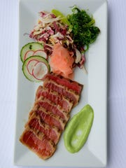 At Joe Amiel's Bay Pointe Inn in Highlands, an order of North Atlantic tuna is cooked with a wasabi soy glaze.