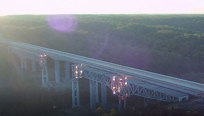 Screen capture of drone footage taken by the Ohio Department of Transportation of the imploding of the Jeremiah Morrow Bridge in Warren County.