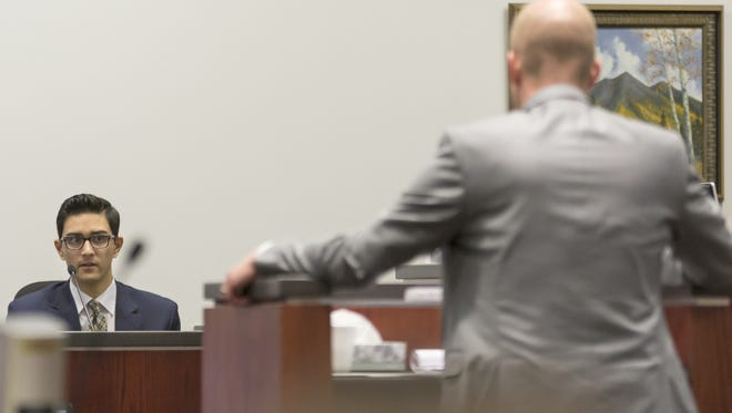 Steven Jones (left) testifies before prosecutor Ammon Barker before a mistrial was declared in the case. A new trial is scheduled for August.