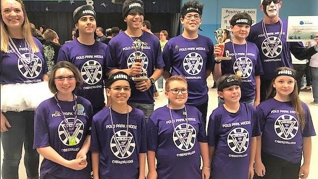 Team Challenger was one of Polo Park Middle School's three robotics teams to place at its regional competition. The students thought of a way to control a small amount of plastic pollution by creating a sauce holder that can attach to french-fry containers.