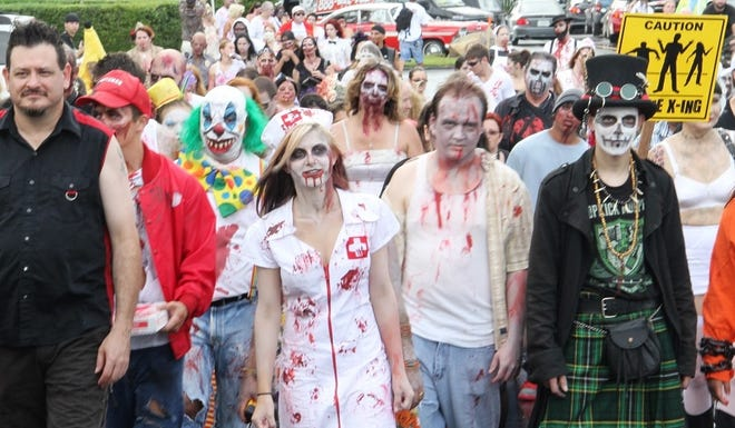A horde of undead line up at the start of one of Spooky Empire's Zombie Walks.