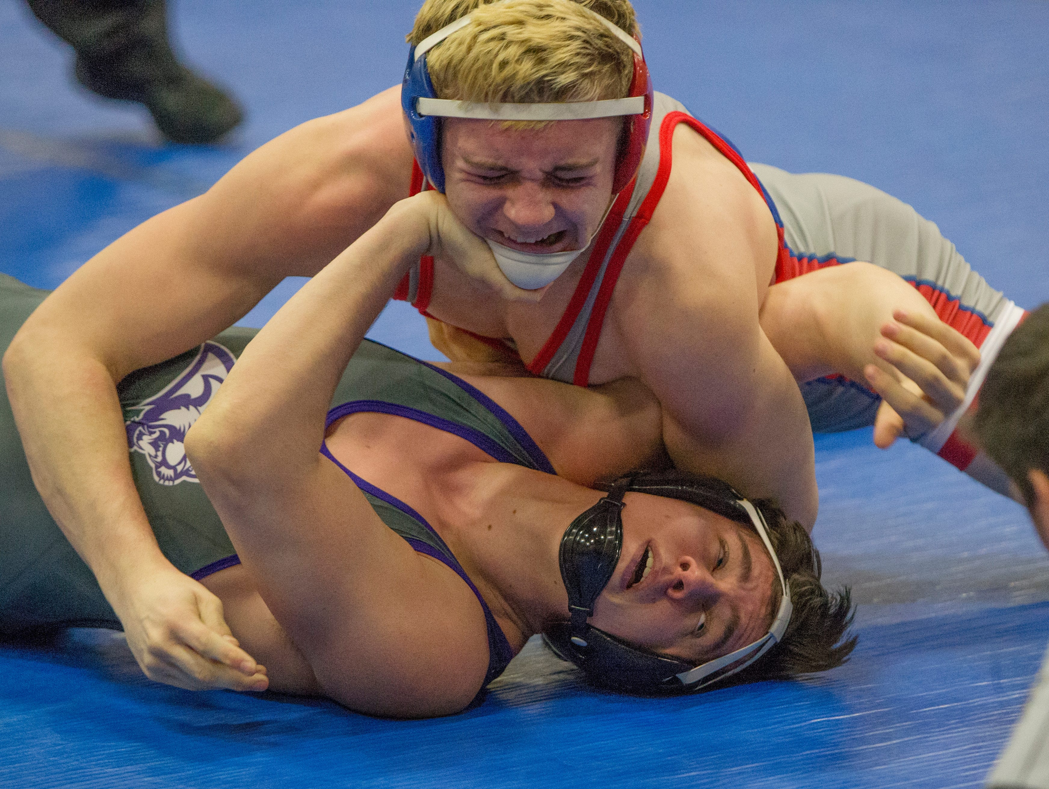 Spanish Springs Cougars Jacob Dye, bottom, wrestles Reno Huskies Devyn Cox in the 160-pound weight class on Wednesday at Reno High School. Dye won by pin.