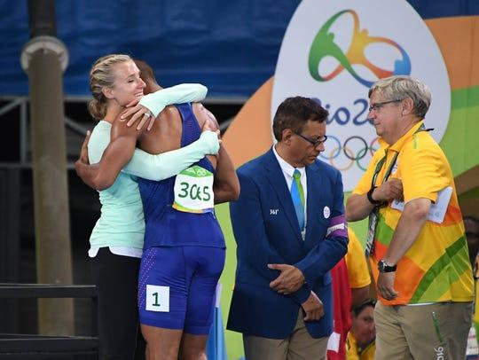 Ashton Eaton celebrates with wife Brianne Thiesen-Eaton