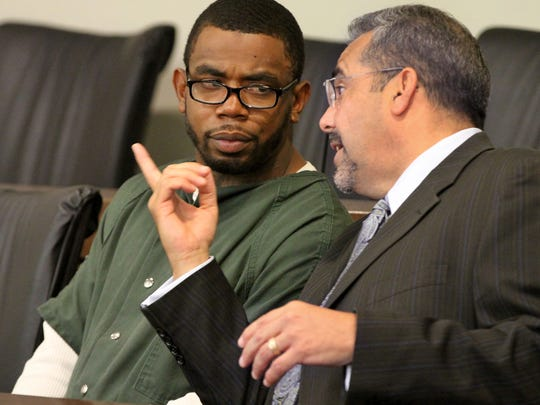 Jeffrey S. Williams, 29, of Long Branch, speaks with his attorney Carlos Diaz-Cobo in Superior Court Judge Vincent Falcetano's courtroom before his detention hearing Tuesday, August 8, 2017.  Williams is charged in the murder of Hector C. Mejia in Long Branch.