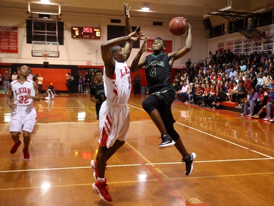 Lincoln's Trinton Bryant lays the ball up against Leon's