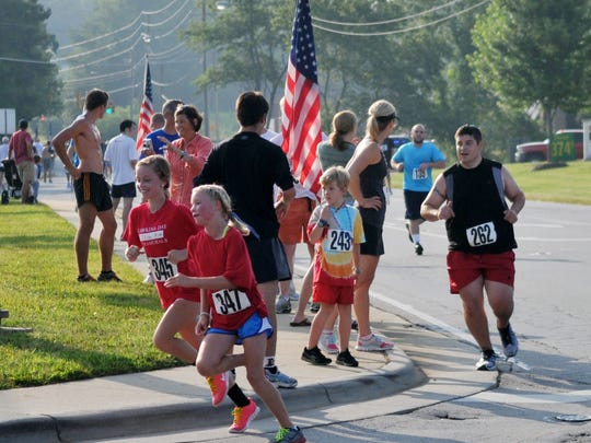 Hundreds competed in the Weaverville Kiwanis Club of North Buncombe's  Firecracker 5K in this file photo. Close to 400 are expected at the Steak 'n Shake Firecracker 5K July 44.