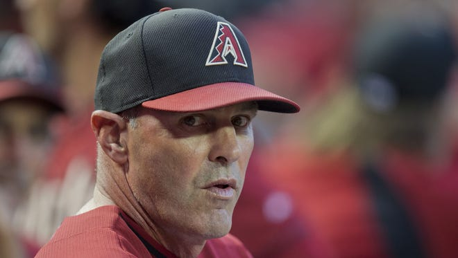 Diamondbacks' manager Kirk Gibson looks out during an exhibition game against the Cubs at Chase Field in Phoenix on Friday, March 28, 2014.