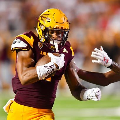 ASU's N'Keal Harry runs after a catch against Texas