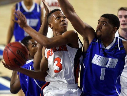 Blackman's Isaiah Hart tries to put up a shot against