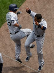 Seattle Mariners' Kyle Seager, left, celebrates with