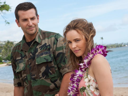 """This photo provided by Sony Pictures Entertainment shows Bradley Cooper, left, and Rachel McAdams in a scene from Columbia Pictures' """"Aloha."""""""