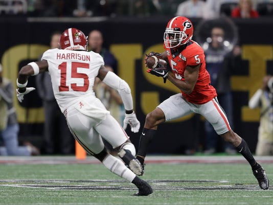 Georgia's Terry Godwin catches a pass in front of Alabama's Ronnie Harrison during the first half of the NCAA college football playoff championship game Monday, Jan. 8, 2018, in Atlanta. (AP Photo/David J. Phillip)