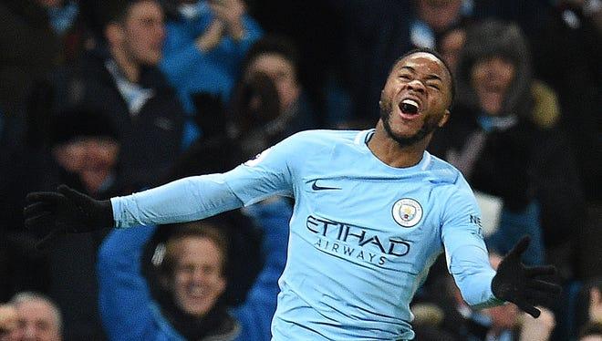 Raheem Sterling celebrates scoring the winning goal.
