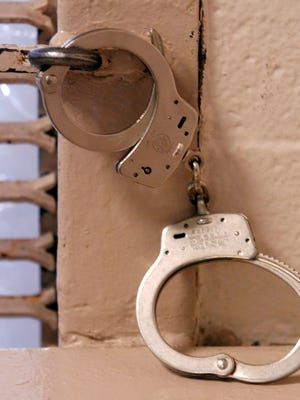 Handcuffs against the wall in the holding area of Lafayette Parish Correctional Center.