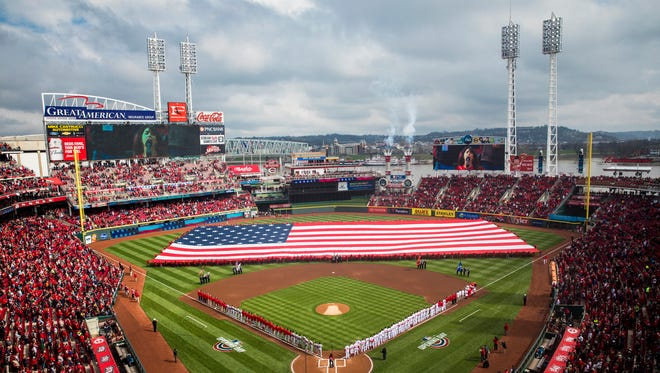Singer-songwriter Nicki Bluhm sings the National Anthem before the season opener at Great American Ball Park Friday, March 30, 2018.