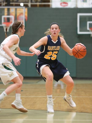 Hartland's Lexey Tobel (25) and Howell's Alexis Miller (left) are among six Livingston County girls who received honorable mention in Associated Press All-State basketball voting.