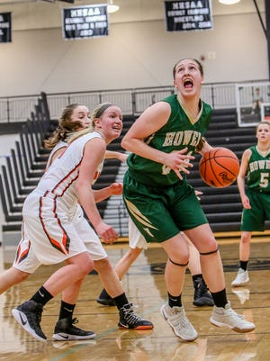 Howell's Leah Weslock drives against fellow all-conference pick Julianna Pietila of Brighton during a four-overtime district semifinal.