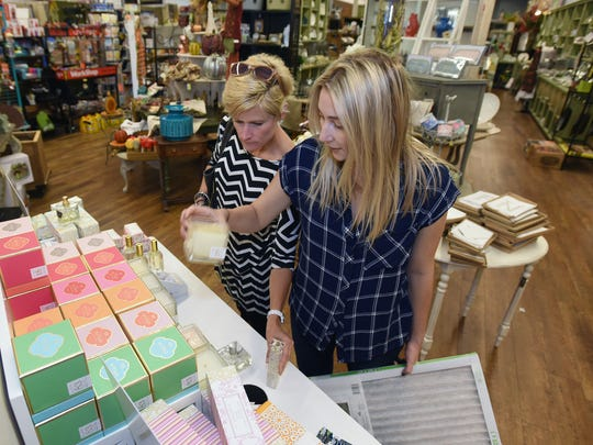 Stacy Moss (left) and Taylor Bregman of Shreveport enjoy the scented candles on display at King Hardware and Gifts.